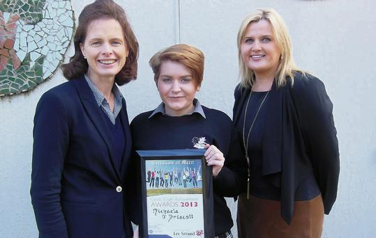 Principal Fiona O'Brien with Garda Youth Achievement Award recipient Michaela O'Driscoll and teacher Kerri McCarthy.