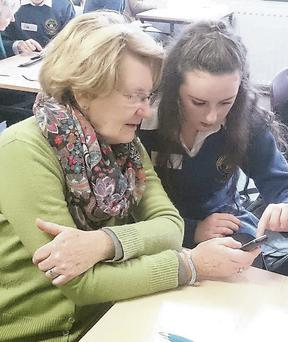 Transition Year students at Pobalscoil Chorca Dhuibhne engaging in the 121Digital initiative with senior members of the community in Dingle recently.
