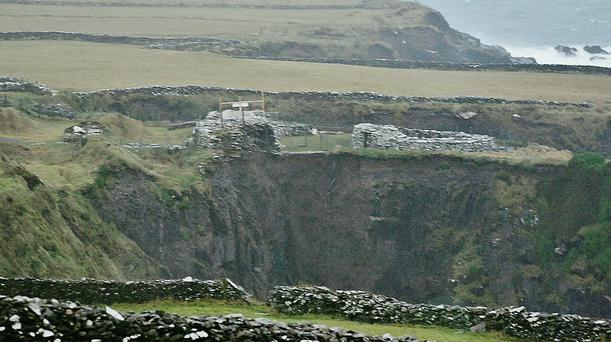 Dunbeg Fort on the Slea Head Drive, part of which has fallen into the sea.