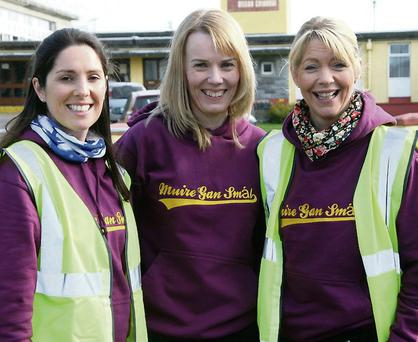 Organising group members Noeleen O'Connor, Maura Browne, deputy principal and Tina Donovan waiting for the participants to return on the Muire Gan Smál 5K fundraising fun run last February.