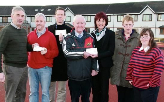 At the presentation of Christmas Morning Charity Mile cheques were Denis McSweeney, manager An Riocht presenting a cheque to Seán Hanley, Oileán Beó; Bill Costello, An Riocht with a cheque for GOAL; Denis Brosnan presenting a cheque to Theresa Looney on the Irish Kidney Association with Margaret Enright and Mary Nelligan, Oileán Beó.