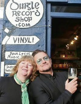 Mazz O'Flaherty and Bono at the Dingle Record Shop in Dingle last Saturday. Photo courtesy of Nuala Moore.