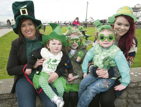 Liz and Caoimhe Duffy, Casey Ryle, Megan Casey and Emily Hobbert having a great time at the Ballyheigue St Patrick's Day parade.
