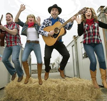 Blennerville National School Parent's Association are inviting theirl friends in low places to a Garth Brooks party in Quane's Bar this Friday where they will meet the likes of this lot - Raphael Crowley, Mary Wallace, Terry O'Sullivan, Blennerville National School Principal and Mary O' Brien.