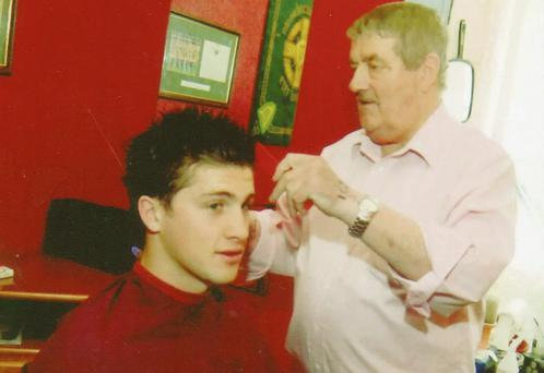 Pete Hanley cutting the hair of the Irish soccer international and Hull City player Shane Long.