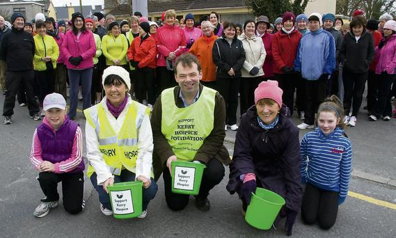 Branch chairman, Jack Shanahan flanked by members, Liz Galwey and Catherine Horan and mascots, Meg Cronin and Marlyn Cahill and some of the participants in the annual Good Friday Morning Hospice Walk on March 29.