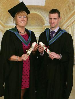 Husband and wife Elaine Clifford and Michael Jones who got first and second plass overall in their Masters in Education through Irish course at NUI Galway.