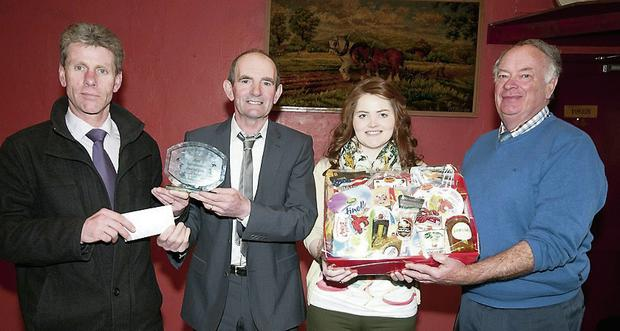Michael Leen and Aileen Corridan being presented with their prizes by Mossie Leahy and Denis Burns.