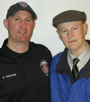 John D Finucane and his fireman son, Sean, who saved his life after he suffered a haemhorrage from a ruptured artery.
