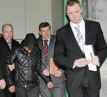 Badri Khvedelidze (32), who is charged with the 2005 murder of fellow Georgian immigrant George Tkeshelashvili in Tralee, being led from Killarney District Court on Monday night. Photo by Michelle Cooper Galvin