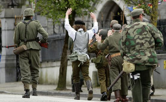 'Prisoners of war' being marched away from the battle scene during last year's Listowel Military Tattoo.