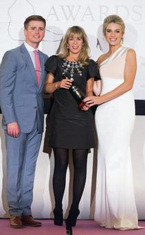 Patrice O'Callaghan of the Listowel Arms Hotel receiving the Best-in-Munster Wedding Venue Co-ordinator award from Brian Ormond and Pippa O'Connor at the Hardy Hi Wedding Awards in the Silver Springs in Cork recently.