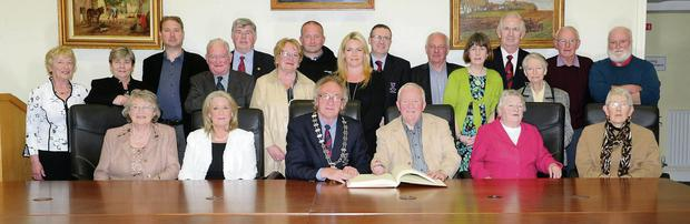 Billy DF O'Sullivan (fourth from left) signing the book at the civic reception accorded by Cllr Michael Gleeson, Deputy Mayor of Killarney for his work in setting up HeartBeat in Killarney, a group that supports people who deal with all types of heart issues. Front, from left: Una Loftus, Olive O'Sullivan, Marie McCarthy and Mary Doyle. Back, from left: Lucy Clifford, Kathleen McCarthy, Matt Clarke, Michael Leane, Cllr Sean Counihan, Mary O'Reilly, William O'Sullivan, Kiara Clarke, Cllr Tom Doherty, Michael O'Leary, Town Clerk, Mairead McCarthy, Killarney Strutters, Cllr Cathal Walshe, Assumpta O'Shea, Michael F O'Connor and Brian McCarthy at the Killarney Town Chambers on Thursday.