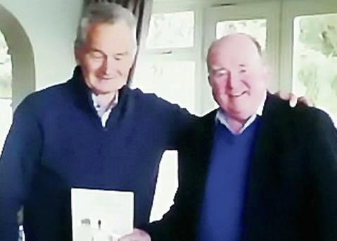 Kenmare pharmacist and President of the Kenmare Historical and Cultural Society James Brosnan (right) presenting an edition of the Kenmare Chronicle to Mick O'Connell.