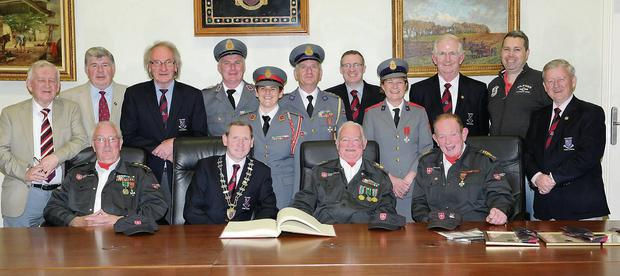 Capt. Donal McCarthy, celebrating 50 years, Adj. Michael Leane, 60 years and Adj. James Looney, 50 years in the Order of Malta Killarney being honoured with a civic reception by Killarney Town Council with Cllr Paddy Courtney, Mayor of Killarney. Back, from left: Cllr. Sean O'Grady, Cllr Sean Counihan, Cllr Michael Gleeson, Adj. Noel Lucey, Officer in Charge, Asst. Commander Catherine Purcell, National Youth Officer; Capt. Joseph Looney, Cllr Tom Doherty, Elenor Johnston, Killarney Medical Officer; Cllr Cathal Walshe, Cllr Niall O'Callaghan and Cllr Donal Grady at the Killarney Council Chambers on Monday.