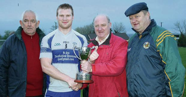 Desmonds captain, Pat Fitzgerald receiving the North Kerry League Division 1 Cup from Con McCarthy with North Kerry GAA Board officers, Mick Flavin and Billy Enright after Saturday's final against Beale.