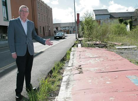 Cllr. Bobby O'Connell has asked Kerry County Council to tackle the problem of dereliction on this site on Castleisland's Limerick Road.