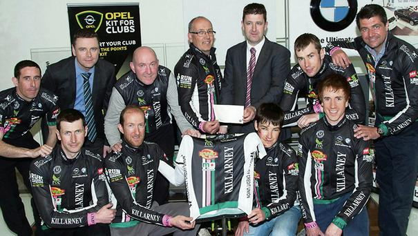 At the announcement of details of the Aherns BMW/OPEL Kerry/An Post Rás team for 2014 were Pat Ahern presenting a sponsorship cheque, with sales manager, Gordan Lunn, to manager, Brendan Cassidy at Ahern's Castleisland showrooms. The team includes Matt Slattery, John Mannix, Mike Lucey, Benny Cassidy, Cathal Moynihan, Brian Hanafin, Brendan Slattery, Physio, Cian Hogan, mechanic and Mike Shaughnessy.