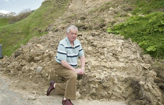 Cllr Tom Beasley at the landslide on the road to Ladies beach, Ballybunion.