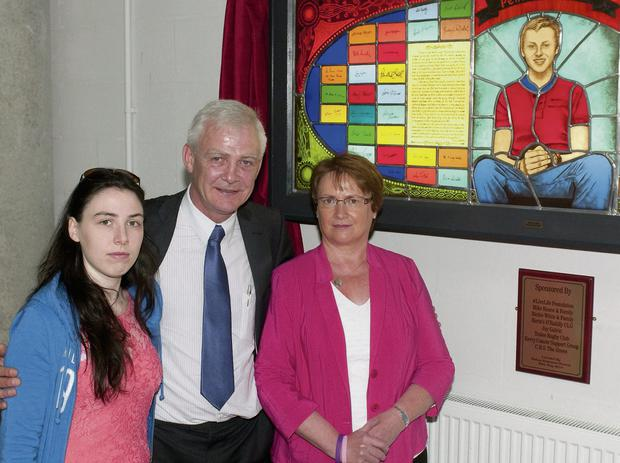 Donal Walsh's sister Jemma, father Fionnbar and mother Elma at the unveiling of the stained glass window of Donal by artist Mary J Leen at the CBS School on the Green. Photo: Eye Focus LTD