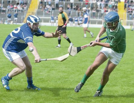 Ballyduff's Barry O'Grady and St Brendan's Kieran Fitzgerald in action in the Garvey's Supervalu County Senior Hurling Championship at Austin Stack Park, Tralee Photo by Eye Focus Ltd