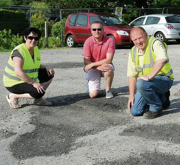 Cllr Damien Quigg (centre) with Orna Eccles and Willie Bateman in the Car Park near the Old Mill, Killorglin, which which needs to be resurfaced