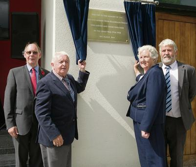 Pa Rochfort and Finola Cronin unveiling the plaque at Library Place, Killorglin to commemorate the men and women from Killorglin Parish who served in the Great War 1914-1918 with Stephen Thompson, organiser and Johnny O'Connor, Killorglin Archive Society on Monday