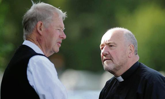 Broadcaster Micheal O'Muircheartaigh and Fr Kevin McNamara at the removal of the late Maureen Cooper (mother of Colm Cooper) at O'Shea's Funeral Home Killarney on Friday evening