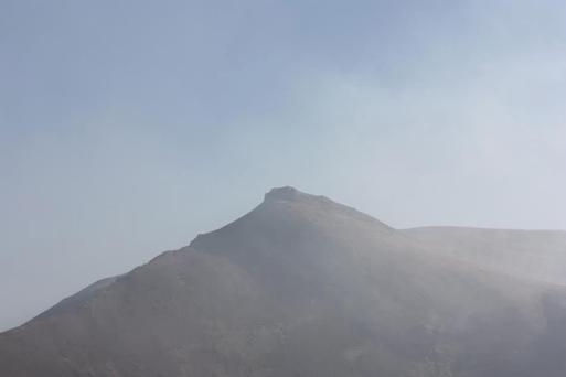 Caherconree shrouded in smoke last Sunday