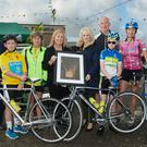Betty Stack Principal of Ardfert NS made a special picture presentation to a former pupil of Ardfert NS Sinead Kissane, now with TV3, with Betty Stack at the presentation along with participants in the Ardfert Harvest Fundraising Cycle for the school, last Saturday