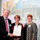 Sandford Award co-sponsor Bisshop Grosseteste University's Vice Chancellor, Reverend Canon Professor Peter Neil presents the award to Kerry County Museum Curator, Helen O'Carroll (centre) and Education Officer Claudia Köhler at the awards ceremony in London Transport Museum