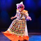 Panto Dame Tom Hanafin in action on stage as Aunt Eve