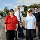 Joanne O'Connor, Rita Murphy and little Kaylee Flynn of Keel Child Care Centre with Sen. Mark Daly and Cllr John Francis Flynn on the main Dingle Road at Keel