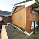 Robert Beasley stands by an area damaged by the bad weather, at Convent Walk Ballybunion