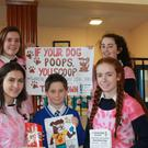 Members of Presentation Tralee's 'If your dog poops you scoop' campaign (Front from left) Nela Vudayova, Sarah Buckely (Back from left) Norah O'Connell, Emma Sheehy with CBS NS Tralee pupil Conor Bradshaw who won a poster contest by the Pres group