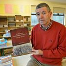 Coolard NS Principal Maurice O'Mahony with a copy of his new history of the school where he's served at the helm since 1973. A History of Coolard National School traces the whole story of the primary from its origin in 1846 until the present. It will be launched by former pupil Joe Murphy at St John's on Saturday, March 5 at 8.30pm. Photo by Domnick Walsh