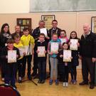 Members of Listowel Comhaltas receive certificates for their stage entertainment on St Patrick's Day in Listowel. From left: adults, Eibhlis Moriarty, Ian O'Shea, chairman Eugene Moriarty, Jimmy Maloney, Matt Mooney, and children, from left: Sean McElligott, Ronan Stack, Aidan Roos, David Flynn, Megan McElligott, Michelle Flynn, Hannah O'Shea, in front: Eleanor O'Shea