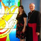 Artist Mary J Leen and Bishop Ray Browne with the new stained glass feature in Mercy Mounthawk's new Centenary Building