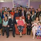 May Scanlan (centre, seated) celebrated with friends and family