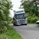 A heavy goods vehicle tries to manoeuvre the bumps and humps in Kilocrim - the road was the issue of a heated discussion in council chambers last week