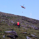 The Coast Guard helicopter was called to the rescue of a hillwalker on the lower northern slopes of Cnoc na Toinne on Sunday