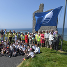 Locals and Kerry County Council staff raised the Blue Flag at Ballybunion Beach on Monday. Photo: EyeFocus