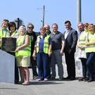 Ballybunion tidy Town and Kerry County council staff with the plaque of Maeve Binchy in Ballybunion town