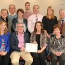 Grace Foley, Killarney, recipient of the Eamon Kelly Arts Bursary 2016 from Kerry County Council Arts Office for the Development and Promotion of the Arts. Also included are: Cllr Bobby O'Connell (Mayor of Killarney Municipal District Area), Kate Kennelly, Kerry County Council Arts Officer and Brid Sugrue. Standing from left are Aidan Reidy, Val Moynihan, Cllr Michael Gleeson, Mary Foley, John O'Sullivan ,Cllr John Joe Culloty, Sharon O'Keeffe and Cllr Donal Grady. Picture: Eamonn Keogh (macmonagle.com)