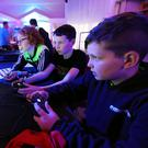 Fionán Bruton, left, Eoin Mannix and Ryan Neeson, from Killarney, playing Minecraft at the Insomnia Gaming festival at the INEC, Killarney at the weekend