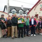Jim Morris (in the Kerry jersey and father of Anthony) presenting Mick O'Connell with a photo of Anthony Morris and Mick. On Jim Morris's left are the Young Islanders Chairman John O'Sullivan and Dan Tim O'Sullivan in company with those who cycled and contributed in various ways
