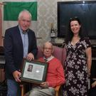 Edward Crowley and daughter Clem O'Keeffe receiving a special presentation from Jimmy Deenihan marking the huge contribution to Irish public life of Edward's War-of-Independence hero father James on Saturday