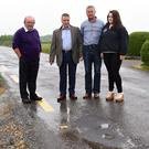 Cllr Damien Quigg (third from left) with Paddy O'Sullivan, Jerry Buckley and Grace O'Sullivan at the main road to Waterville where road conditions are deteriorating rapidly. Photo Michelle Cooper Galvin