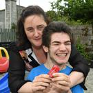 Castleisland woman Nicola Lawless with her 19-year-old son Ben who requires constant care. The family's request for respite was rejected by the HSE