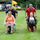 Off to a great start...Contestants in the wheelbarrow race at the Annual Glencar Cattle Show & Carnival, Co Kerry on Sunday.